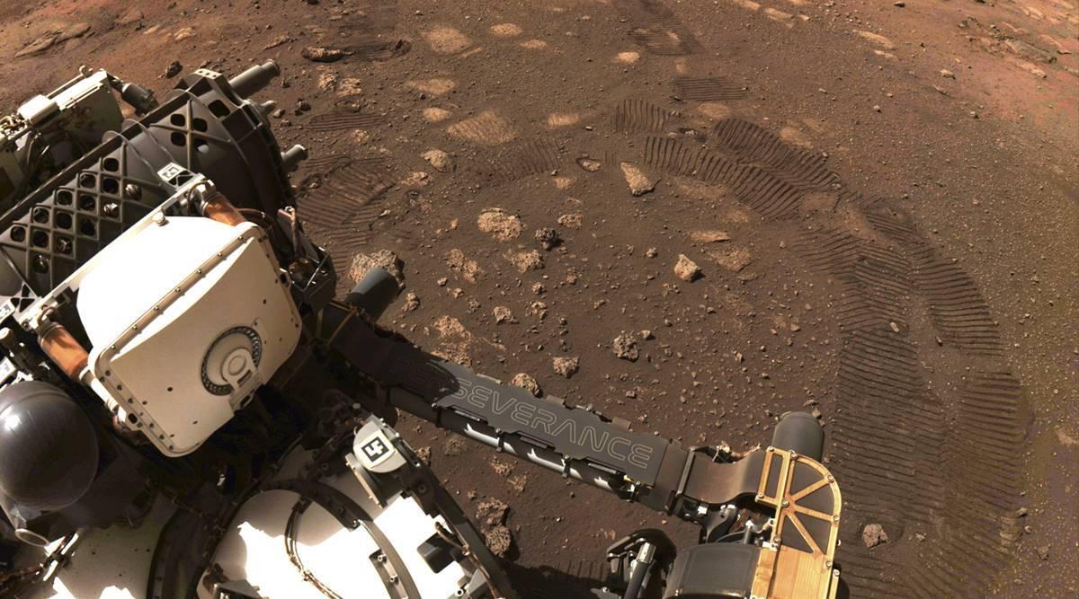 NASA's new Mars rover hits dusty purple street, 1st journey 21 ft